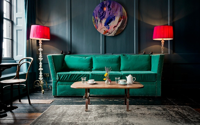 Location photography. Interior of Soho club, Green sofa and morning tea.