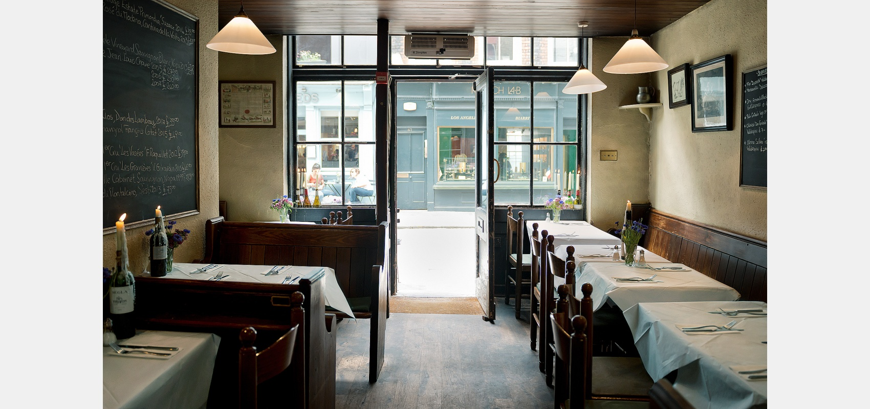Location photography/Hidden Soho/ small restaurant interior/ looking out/onto street.