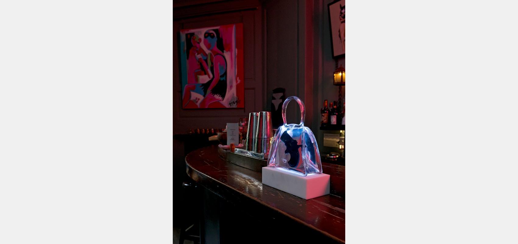 Location photography/Hidden Soho/club interior/ handbag & gun /artwork/ bar.