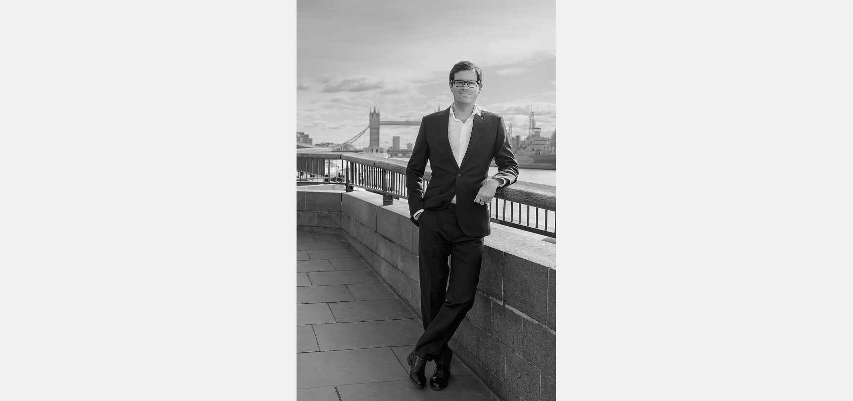 Business portrait. Thames Embankment/Company Partner/ suit/Tower Bridge/ in background.