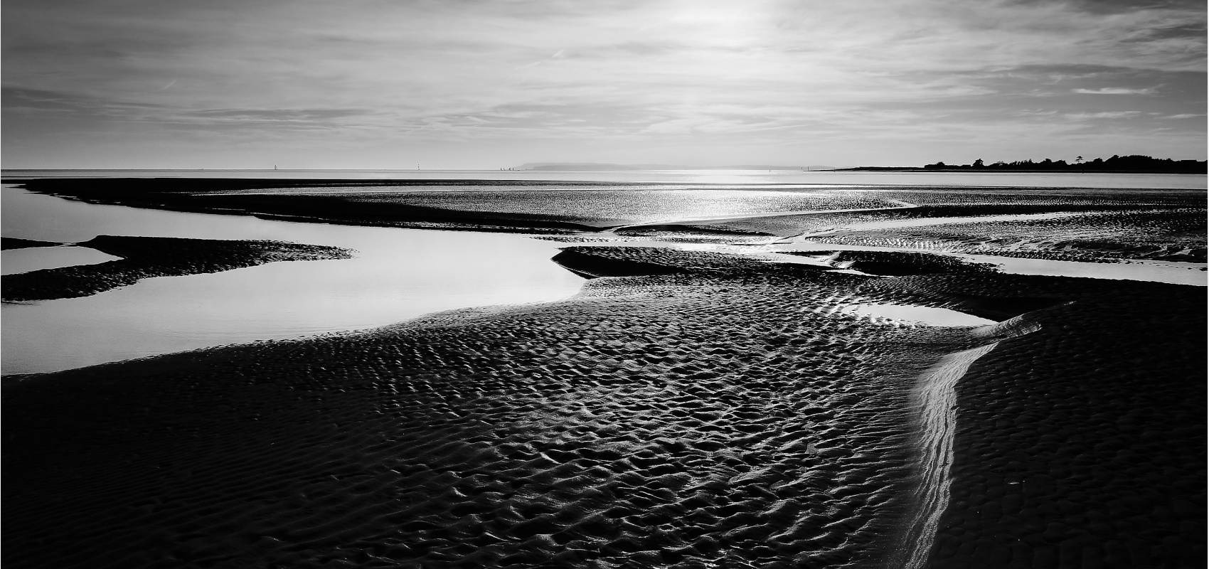 Coastal series. Beach at low tide and the sand patterns revealed.