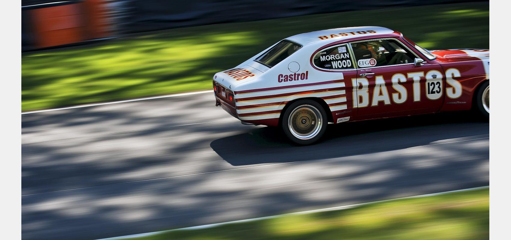 Motorsport - 1972 Ford Capri Weslake RS2600 racing through dappled light.