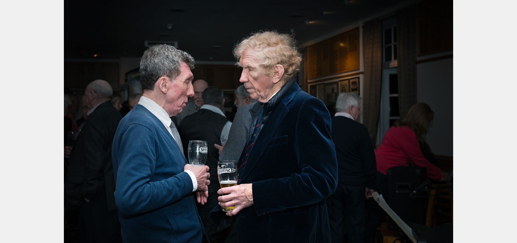 Event photography. Club celebrations, two friends in conversation.