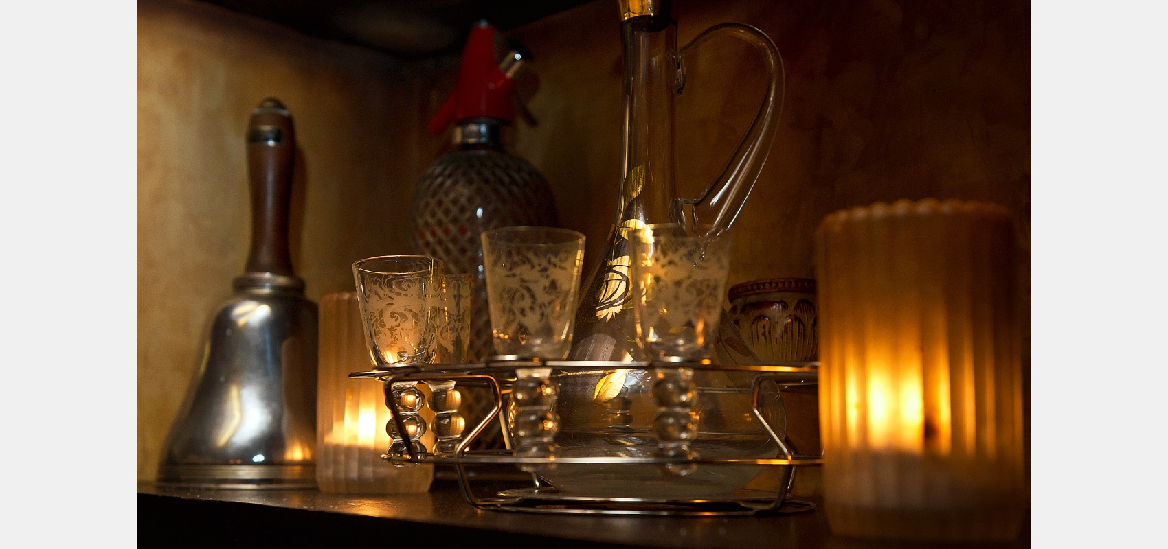 Interior photography/Hidden Soho,/Art Nouveau/ decanter/ shot glasses/ club interior.
