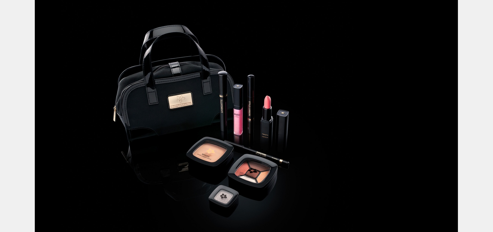 Product photography. Cosmetics/L'etoile Beaute International/ cosmetics items/ on black.