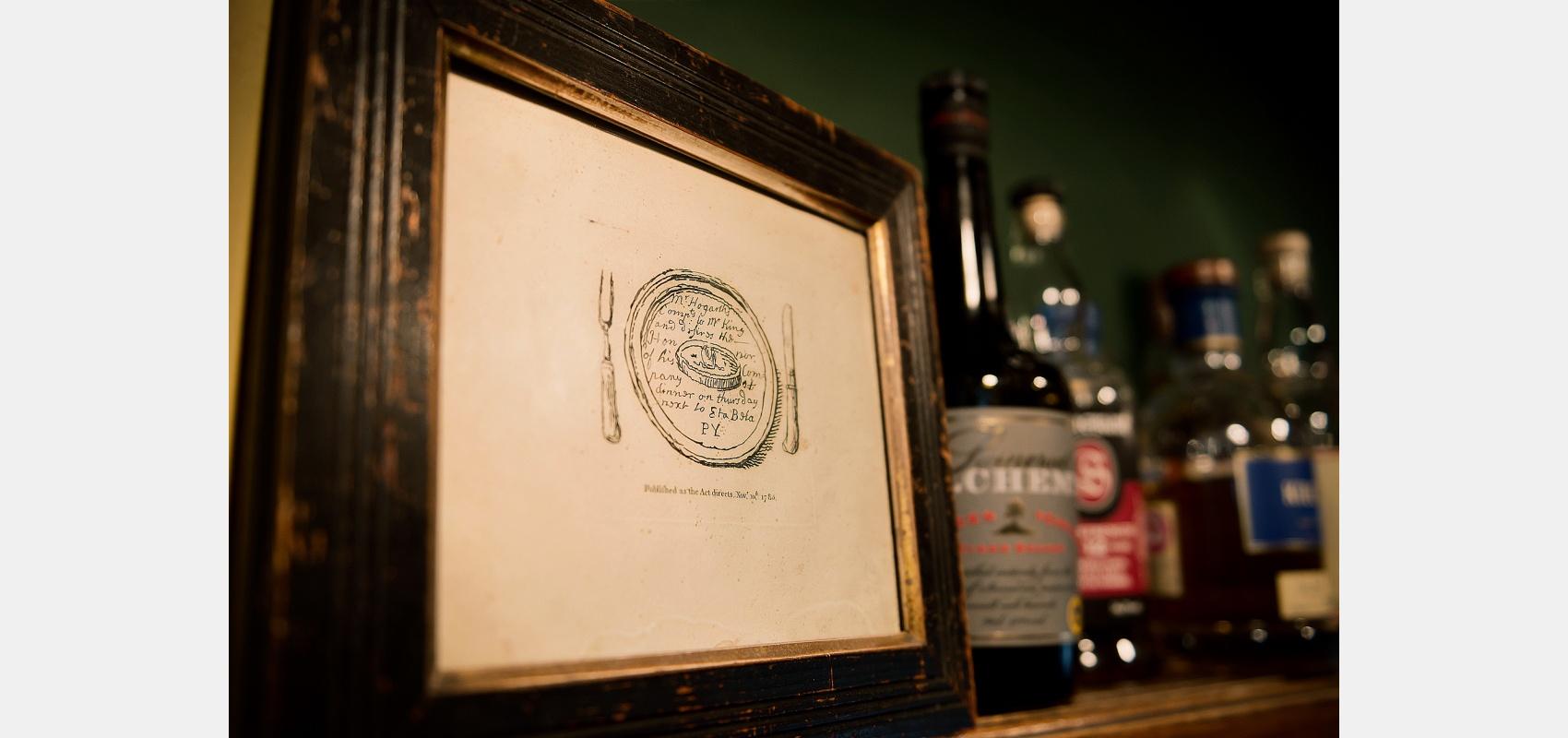 Location photography/Hidden Soho/restaurant interior/ framed print of Mr Hogarth's dinner invite to Mr King/1784.