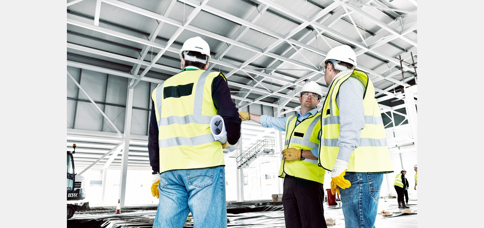 Constructionphotography/interior image of building/managers on site inspection of new lab.
