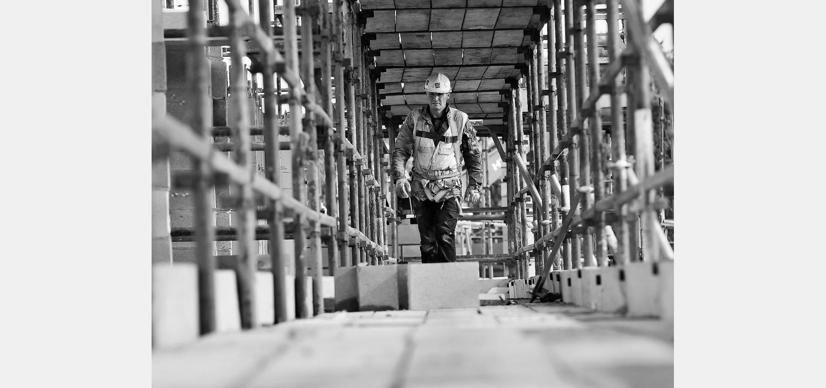 Construction worker - Steeplejack on gantry.Black & white, image