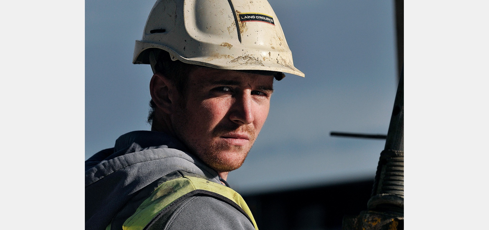Construction. Portrait of young construction worker. Face to camera.