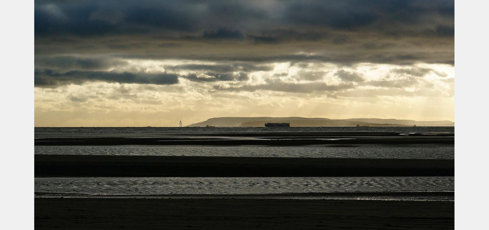 Location photography,Coastal, Ships, entering the Solent, under dark skies.